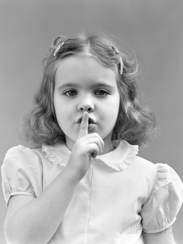 1940s-1950s-girl-with-finger-to-lips-making-quiet-shush-gesture.jpg