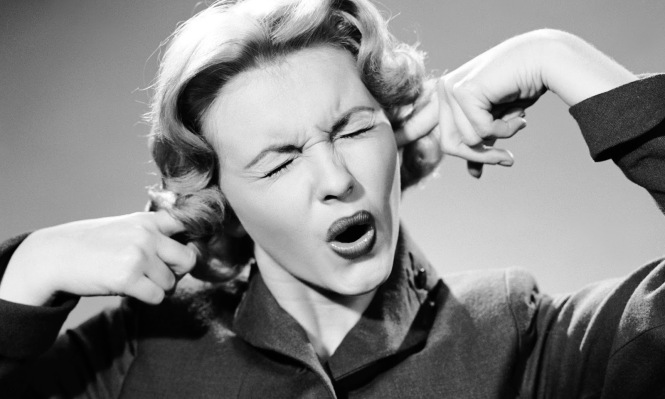 Vintage-fingers-in-ears-not-listening.jpg